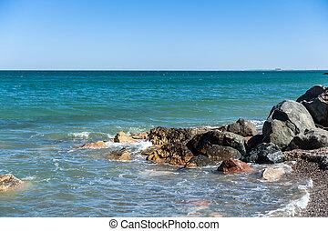 Face in Stone over sea
