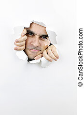 Face looking through hole in paper