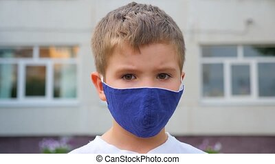 Boy in a surgical bandage. Coronavirus, illness, infection, quarantine, medical mask, COVID-19. Boy in a medical mask. Quarantine and protection virus, flu, epidemic COVID-19. Coronavirus quarantine.