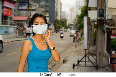 face mask in bangkok - young asian woman with face mask in...