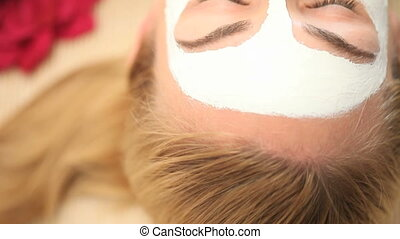 Face mask on blonde woman