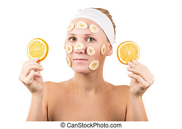 face mask - A young girl makes a face mask.