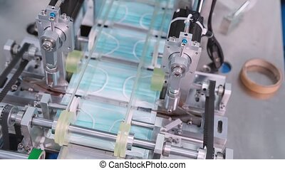 Face mask production line in modern factory . Concept of ...