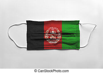 Face mask with Afghanistan flag printed, on white background, isolated