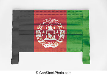 Face mask with Afghanistan flag printed, on white background
