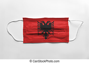 Face mask with Albania flag printed, on white background, isolated