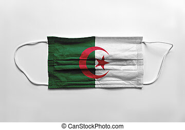 Face mask with Algeria flag printed, on white background, isolated