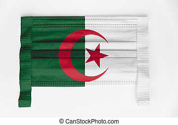 Face mask with Algeria flag printed, on white background, isolated.