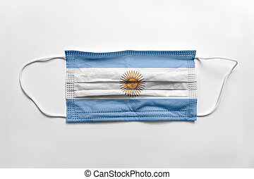 Face mask with Argentina flag printed, on white background, isolated