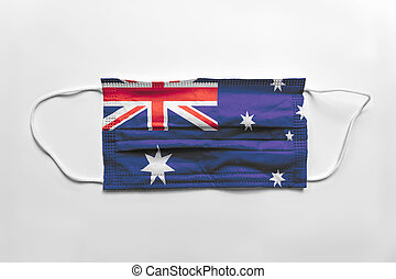 Face mask with Australia flag printed, on white background, isolated