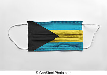 Face mask with Bahamas flag printed, on white background, isolated