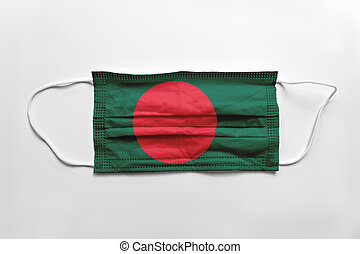 Face mask with Bangladesh flag printed, on white background, isolated