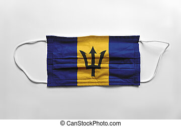 Face mask with Barbados flag printed, on white background, isolated