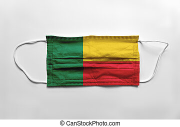 Face mask with Benin flag printed, on white background, isolated