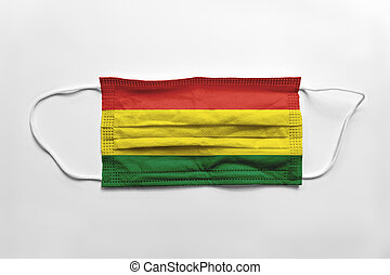 Face mask with Bolivia flag printed, on white background, isolated