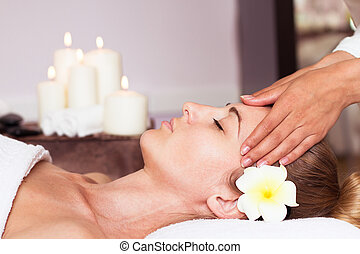 Face Massage. Close-up of a Young Woman Getting Spa