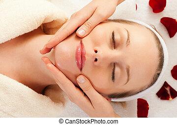 Face Massage in Spa - Beautiful woman enjoying a face...
