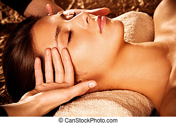 face massage - woman getting  face  massage in spa