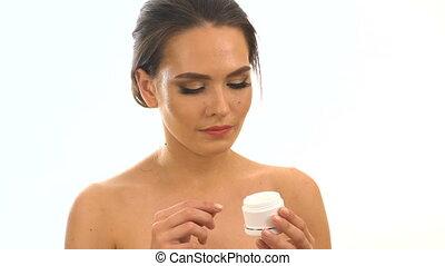Face moisturizer by girl applying moisturizer. Slow motion....