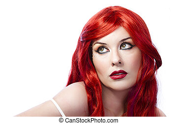 Face of a beautiful young woman with redhair
