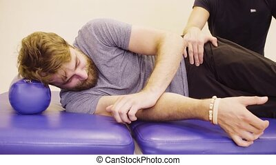 Face of a disable man during exercises at the rehabilitation...