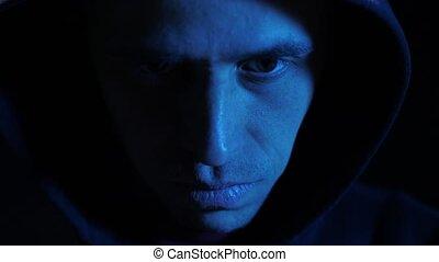 Face of a man at the dark