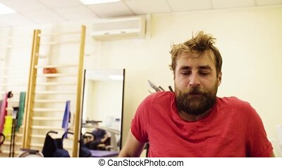 Face of a man during exercises at the rehabilitation center...
