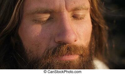 Face of a man with closed eyes - Yogi sitting in meditation...