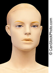 Face of a mannequin isolated on black background