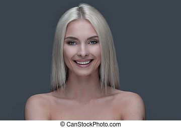 Face of a well-groomed modern young woman with proper...
