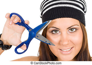 Face of a woman with hand holding scissors