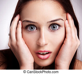 Face of amazed young woman