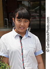 face of asian teen aged standing with smiling face