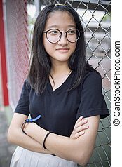face of asian teenager wearing eye glasses