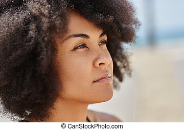 Face of beautiful pensive afro american woman