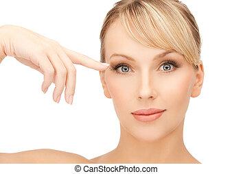 beautiful woman touching her eye area - face of beautiful...