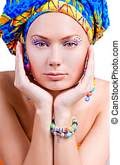 face of beautiful woman with bright eyes and hat