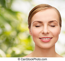face of beautiful woman with closed eyes