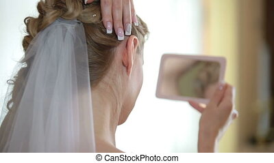 face of bride in  mirror