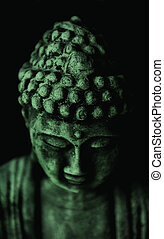 Face of Buddha in green