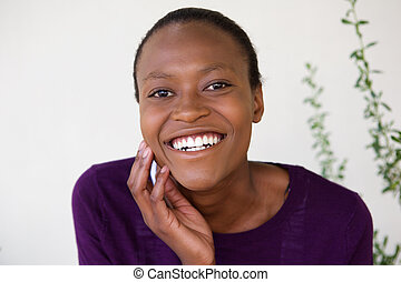 Face of cheerful african woman