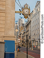Face of clock in the city center of London England