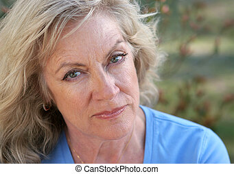 Face Of Distrust - A beautiful mature woman looking hurt and...