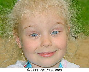 face of distrustfully surprised little caucasian girl