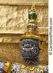 Face of green demon guardian