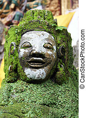 Face of green demon