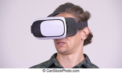 Face of handsome hipster man using virtual reality headset