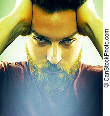 Face of handsome man with hipster style beard