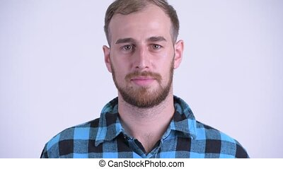 Face of happy bearded hipster man smiling
