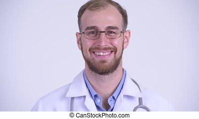 Face of happy bearded man doctor nodding head yes - Studio...